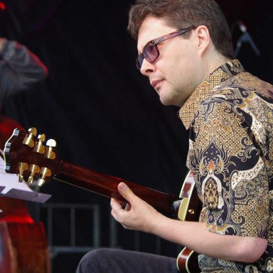 Reg Schwager on guitar